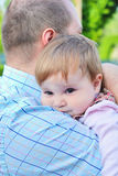 Dad and daughter. Happy family, little girl resting on father's shoulder Royalty Free Stock Image