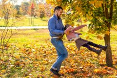 Dad and daughter in the autumn park play laughing stock photography