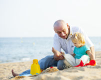 Dad and daughter on  beach. Stock Photo