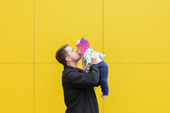 Dad and daughter with a big kiss Stock Photography