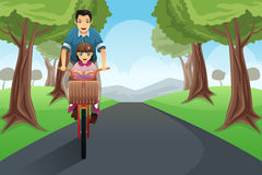 Dad daughter biking together Royalty Free Stock Photos