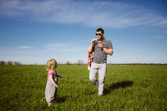 Dad and daughter blow bubbles Stock Photography