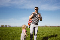 Dad and daughter blow bubbles Royalty Free Stock Images