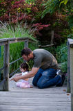 Dad and daughter on a bridge Royalty Free Stock Photos