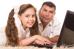 Dad and daughter with computer Royalty Free Stock Images