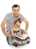 Dad and daughter doing homework Stock Photography