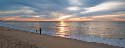 Dad and daughter fishing at sunrise on beach in San Jose Del Cabo in Baja California Mexico. BCS Stock Photo