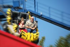 Dad and Daughter Fun. Father and daughter having great time on rollercoaster Stock Photo
