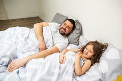 Dad and daughter have fun at home on the bed. Father`s Day. royalty free stock photography