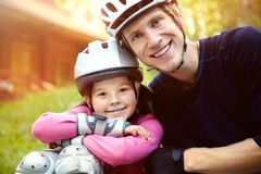 Dad and daughter in a helmet Stock Photography