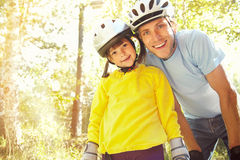 Dad and daughter in a helmet Stock Image