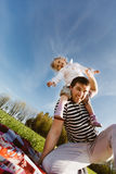 Dad with a daughter on his shoulders laughing Royalty Free Stock Images