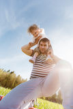 Dad with a daughter on his shoulders laughing Royalty Free Stock Photography