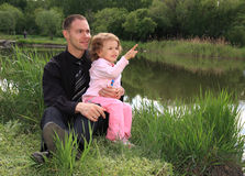 Dad with daughter on nature. Royalty Free Stock Images