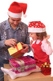 Dad with daughter open gifts. Stock Images