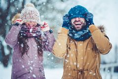 Dad with daughter outdoor in winter. Handsome young dad and his little cute daughter are having fun outdoor in winter. Enjoying spending time together. Family Royalty Free Stock Photo