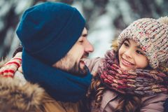 Dad with daughter outdoor in winter royalty free stock image