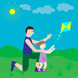 Dad and daughter playing with a kite. Royalty Free Stock Photos