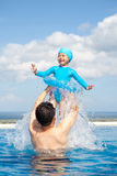 Dad and Daughter playing in swimming Pool Stock Images