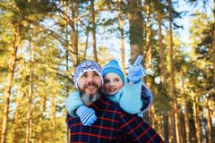 Dad and daughter are playing in the woods. Dad and daughter are playing in the winter forest Royalty Free Stock Images