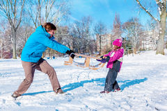 Dad daughter pulling sledges Stock Photography