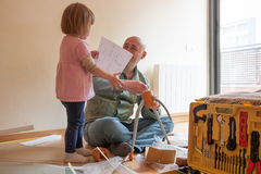 Dad and daughter renovating table stock photos