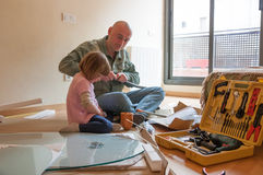 Dad and daughter renovating table stock images