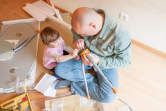 Dad and daughter renovating table royalty free stock photos