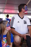 Dad and a daughter supporting US Women Soccer team Royalty Free Stock Photos