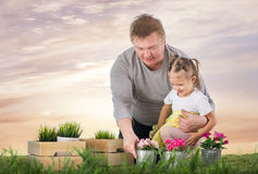 Dad and daughter are thrown flowers Stock Photos