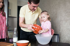 Dad and daughter together in the kitchen Stock Image