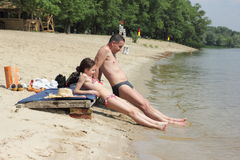 Dad and daughter on a vacation. Father and daughter resting on a river beach on the River Dnepr. Kiev. Ukraine. the holidays royalty free stock photos