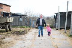 Dad and daughter in the farm royalty free stock photos