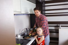 Dad and daughter washing dishes royalty free stock photography
