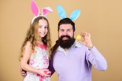 Dad and daughter wear bunny ears. Father and child celebrate easter. Spring holiday. Easter spirit. Easter activities. For whole family. Happy easter. Holiday royalty free stock image