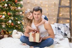 Dad and daughter, white t-shirt, blue jeans, gift box. Beautiful dad and daughter, has happy fun smiling face, dressed in white t-shirt, blue jeans, hold Stock Images