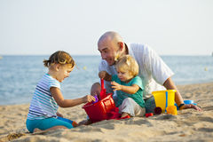 Dad and daughters playing Royalty Free Stock Photo