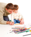 Dad drawing with son Stock Images