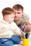Dad drawing with son Stock Image