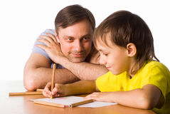 Dad draws with sons. Portrait of a dad drawing with sons Royalty Free Stock Image