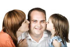 Dad getting kisses Royalty Free Stock Images