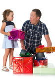 Dad gives daughter gifts Stock Photo