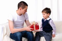Dad gives his son a gift Royalty Free Stock Photography