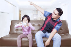 Dad gives order on his daughter to stop a game Royalty Free Stock Photography