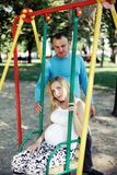 Dad having fun pregnant wife in the park during Royalty Free Stock Photos