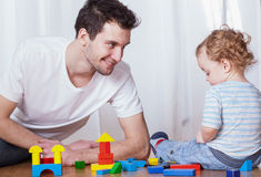 Dad having fun with son. Young dad having fun with his son stock photo