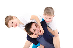 Dad having fun with sons Royalty Free Stock Photography