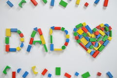 DAD and a heart with colorful wooden toy blocks stock image