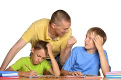 Dad helping children with their homework Royalty Free Stock Images