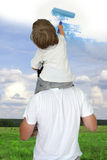Dad helping son to draw good weather Royalty Free Stock Photography